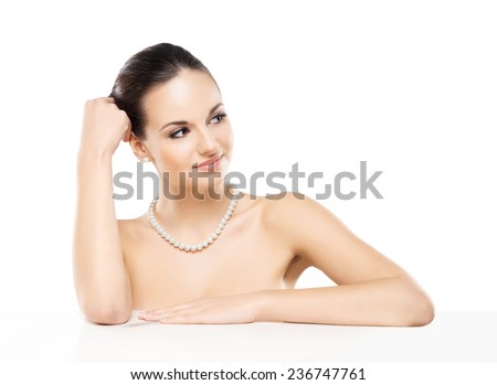 Portrait of young, beautiful and healthy woman in a pearl necklace isolated on white - stock photo