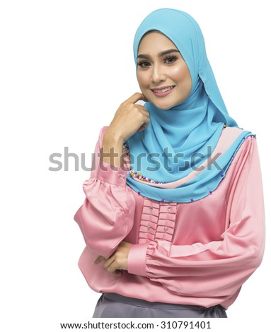 Portrait of young beautiful Asian muslim woman wearing hijab. - stock photo