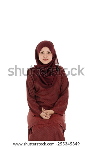 Portrait of young beautiful asian muslim woman wearing hijab isolated on white - stock photo
