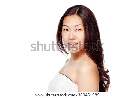 Portrait of young beautiful asian woman with long brown hair and fresh makeup wearing white dress isolated on white background - beauty concept - stock photo