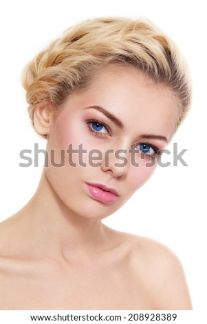 Portrait of young beautiful blond girl with braids and fresh pink make-up over white background