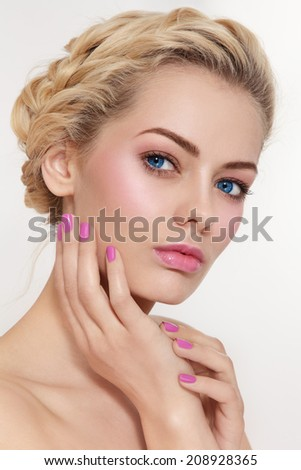 Portrait of young beautiful blond girl with fresh pink make-up and manicure  - stock photo