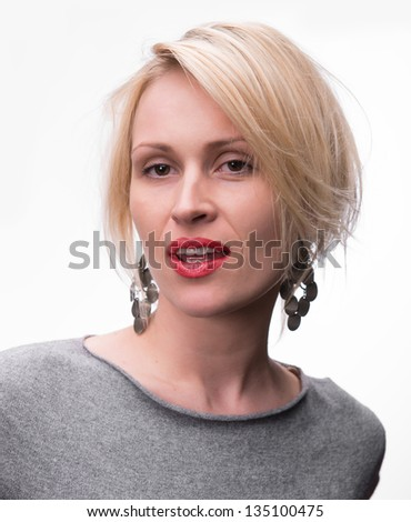 Portrait of young beautiful blond girl with red lipstick on a white background