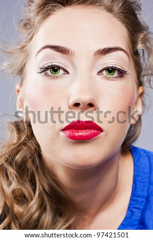 Portrait of young beautiful blond girl with stylish make-up - stock photo
