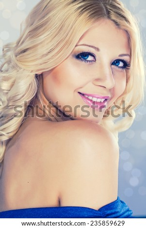 Portrait of young beautiful blond woman with fashion make-up and hairstyle - stock photo