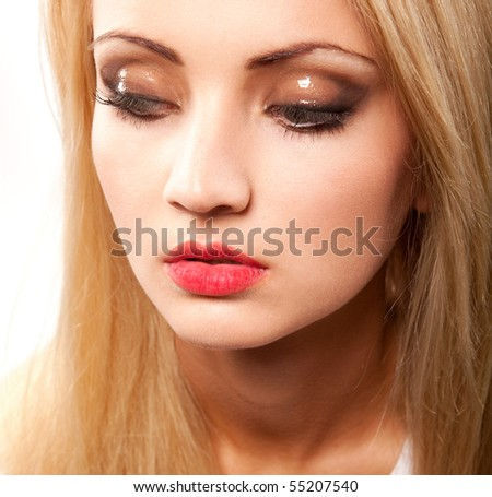 portrait of young beautiful blond woman with makeup