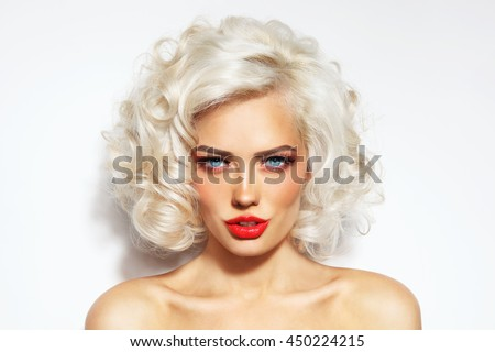 Portrait of young beautiful blonde sexy woman with stylish hairdo and red lips - stock photo