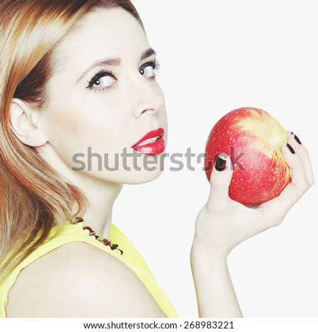 Portrait of young beautiful blonde woman with an apple - stock photo