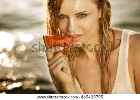 Portrait of young beautiful blonde woman with watermelon slice. Summer style. Healthy food.