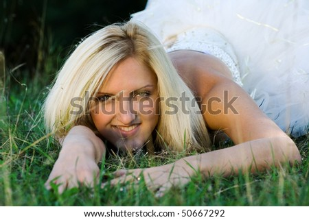 portrait of young beautiful bride in summer outdoor