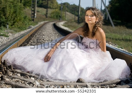 portrait of young beautiful bride in summer outdoor - stock photo
