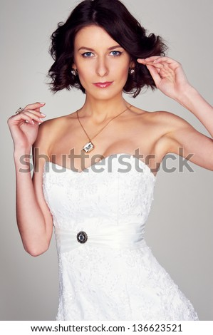 portrait of young beautiful bride in white dress - stock photo