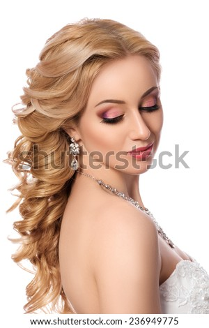 Portrait of young beautiful bride. Wedding coiffure and make-up. - stock photo