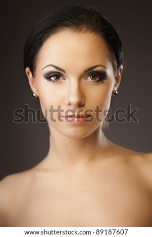 Portrait of young beautiful brunette - stock photo