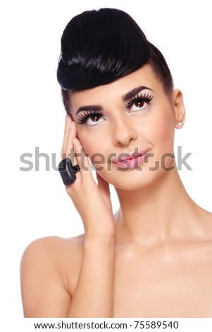 Portrait of young beautiful brunette with stylish make-up and fancy hairstyle on white background