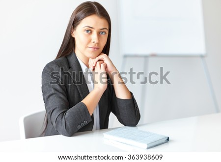 Portrait of young beautiful business woman in the office - stock photo