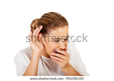 Portrait of young beautiful businesswoman overhears - stock photo