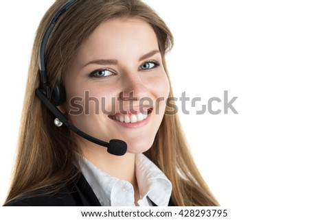 Portrait of young beautiful call center worker talking to someone. Smiling customer support operator at work. Help and support concept. Portrait over white background - stock photo