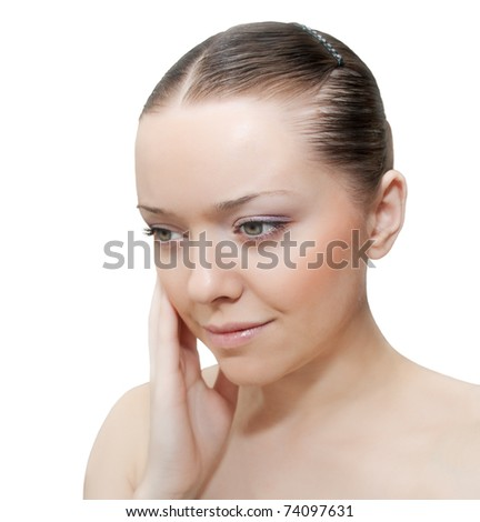 Portrait of young beautiful caucasian woman ???? hand touching face - stock photo