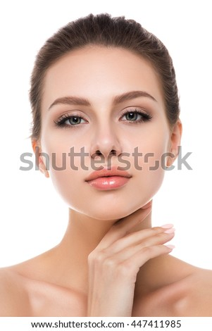 Portrait of young beautiful caucasian woman touching her face isolated over white background. Cleaning face, perfect skin. SPA therapy, skincare, cosmetology and plastic surgery concept - stock photo