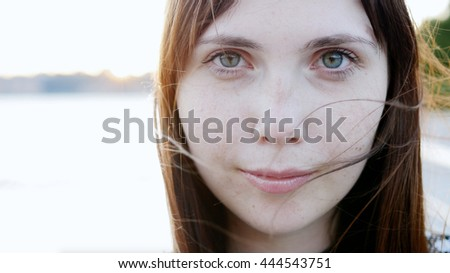 portrait of young beautiful caucasian women face close up. attractive female person background - stock photo