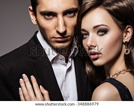 portrait of young beautiful couple in love. close-up - stock photo