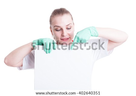Portrait of young beautiful doctor holding a blank box with copy space pointing down isolated on white - stock photo