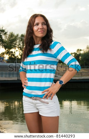 Portrait of young beautiful female near the lake - stock photo