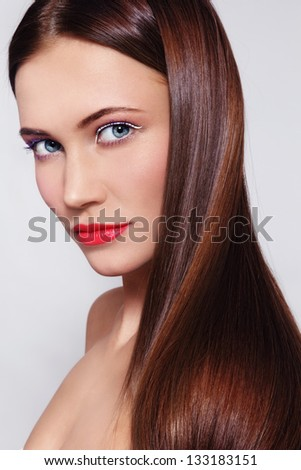 Portrait of young beautiful fresh woman with long shiny healthy hair