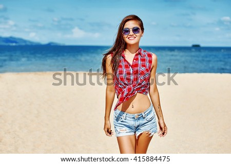 Portrait of young beautiful girl at the beach - stock photo