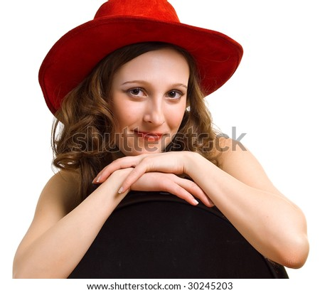 Portrait of young beautiful girl in a red hat. Isolation on a white background - stock photo
