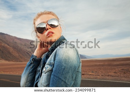portrait of young beautiful girl in death valley environment  - stock photo