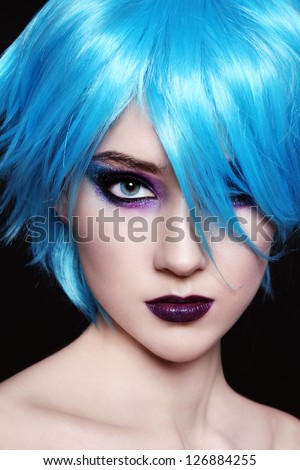 Portrait of young beautiful girl in fancy blue wig - stock photo
