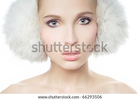 Portrait of young Beautiful girl in fur ear muffs - stock photo