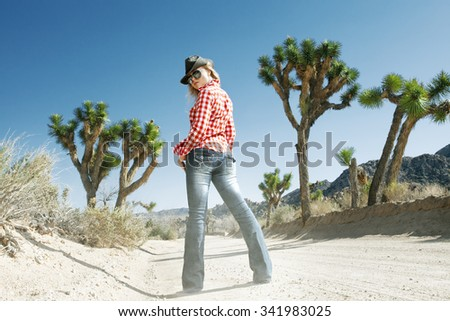 portrait of young beautiful girl in Joshua Tree park environment - stock photo