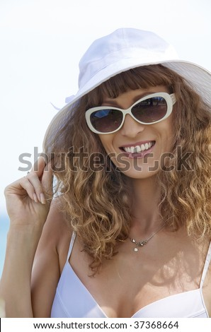 Portrait of young  beautiful girl in  white sunglassses