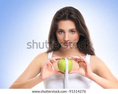 Portrait of young beautiful girl with apple