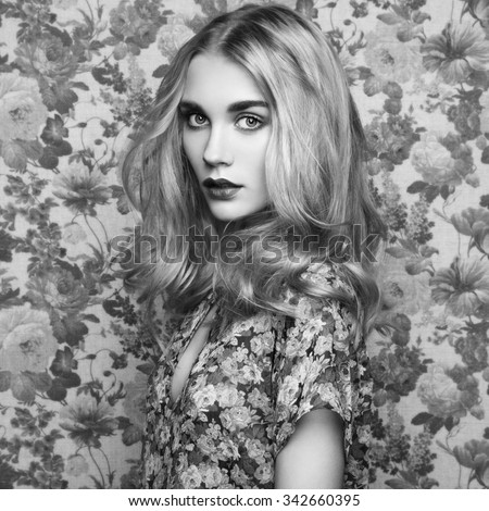 Portrait of young beautiful girl with blonde hair. Fashion photo Hairstyle. Make up. Black and white photo - stock photo