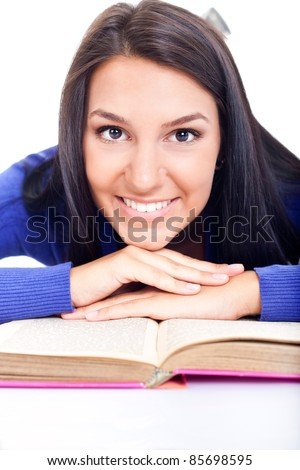 portrait of young beautiful girl with book