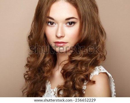 Portrait of young beautiful girl with brown hair. Fashion photo Hairstyle. Make up. Vogue Style. - stock photo