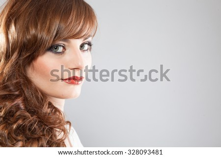 portrait of young beautiful girl with clear eyes and chic makeup - stock photo