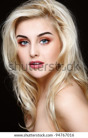 Portrait of young beautiful girl with curly blond hair and stylish sparkly coral make-up - stock photo