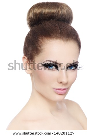 Portrait of young beautiful girl with fancy cat eyes over white background
