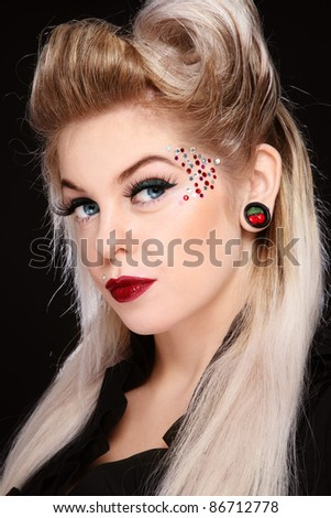 Portrait of young beautiful girl with fancy make-up and hairdo