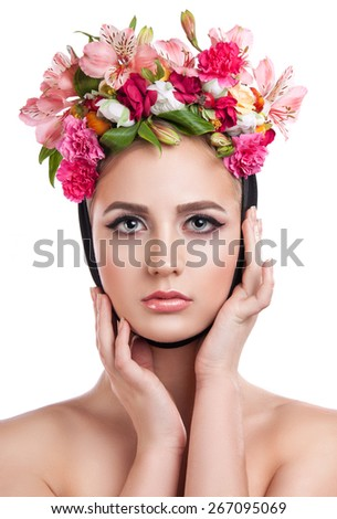 Portrait of young beautiful girl with flowers in her hair. Isolation on a white background - stock photo