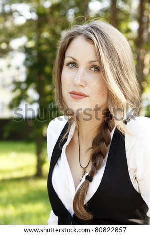 Portrait of young beautiful girl with freckles - stock photo