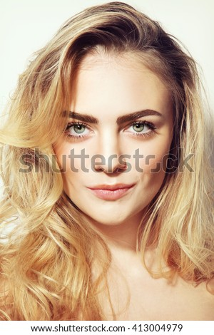 Portrait of young beautiful girl with long messy hair and clean make-up - stock photo