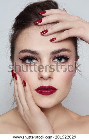Portrait of young beautiful girl with red lips and manicure - stock photo