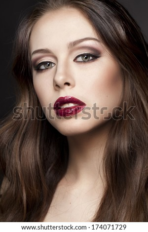 Portrait of young beautiful girl with red lips. Beauty photo