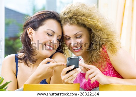 Portrait of young beautiful girls  with mobile phone